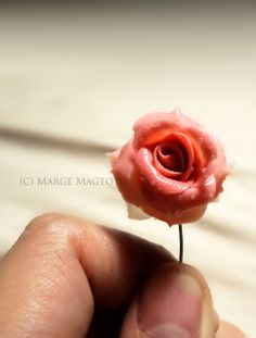 Premo Sculpey realistic polymer clay rose. Still thinking of what to make out of this charm. Bracelet, Ring or Necklace?