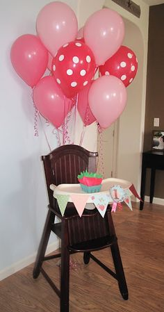 High chair all decked out for a birthday.