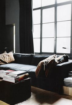 Architecture & Interior Design - Modern Surfaces moody living room with natural light