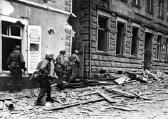 Troops of the 80th US Infantry Division advance cautiously down a ruined street in the German city of Wadern, March 17, 1945. Resistance in urban areas remained stiff until the very end of hostilities, causing immense damage that could have been avoided in the absence of maniacal Nazis.