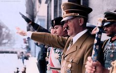 Adolf Hitler with Mussolini's son-in-law and Joachim von Ribbentrop, attend a Nazi Party rally, ca 1930s