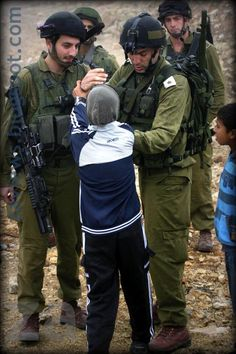 Israeli police assault a Palestinian child..coward Israeli soldiers!! The IDF the devil's spawn on earth