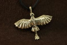 Toothless httyd pendant necklace How to train by DemiurgusDreams