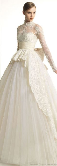 Zuhair Murad bridal couture.  Vintage inspired in winter white las with wide ivory sash and bow.  Demure loveliness.