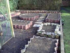 how to use roofing tiles as garden border... garden that I have been busy doing for a friend using old roof tiles.