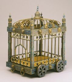 Dog Cage, China, 1736-1795  (c) The Philadelphia Museum of Art. This elaborate dog cage epitomizes the luxurious life of the imperial court during the long reign of the Qianlong emperor, when the extravagant display of wealth extended even to the accouterments of the imperial kennels. The body of the cage is decorated with the intricate enameling technique known as cloisonné. A miniature palace on wheels!