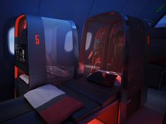 Nike Helps Design a Swank Jet for Traveling Sports Teams | Seats are labeled with the player's jersey numbers, feature flyknit privacy canopies, and when fully reclined, allow a seven-foot tall center lie flat.  Teague  | WIRED.com