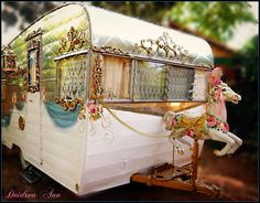 Cinderella's coach. 1963 Shasta got her horse today. This is just a prop when she is parked at the campground!