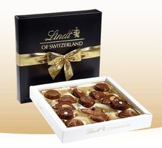 """Lindt Chocolates on Pinterest http://pinterest.com/lindtchocolate/ ~ From their """"Gifts"""" board. ~ For the dark chocolate lover in your life....This collection of 14 pieces includes 8 premium recipes: Caramelita, Macchiato, Vanilla, Elite, Mandoline, Nussfin, Giandujotti, and Cornet Reve.  $20.00."""