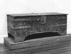 Chest 14th century Of walnut, iron bound; cover modern. Iron straps with scrolled ends; ornamented lock plate and hasp.