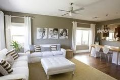 open plan lounge dining room  - colours and photos on wall