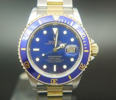 The Rolex Blue Dial Bi-Metal Submariner Ref 16803 Circa 1988 is one of our top selling Vintage Mens Rolex's. The Bezel, crown, insert and dial are all original. The watch sits on a Bi-Metal Oyster bracelet with shows no sign of wear. It comes with its original Rolex box and paperwork along with our one year warranty.