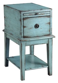 In a weathered and distressed sea blue finish, this simple cabinet has a bold personality full of rustic charm. One single deep drawer has a decorative pull and there is a pullout tray to extend the a