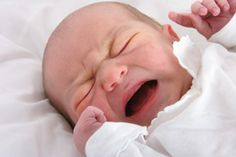 Reflux or colic: symptoms of both, and helping a baby with either