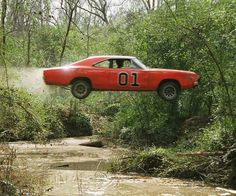 Dukes of Hazzard TV Show 1969 Dodge Charger called the General Lee. Here in my hometown a store has one of the cars like this used as a stunt car. Dodge Charger 1969, Rat Rods, Famous Movie Cars, Film Cars, Dukes Of Hazard, Automobile, Old Classic Cars, American Muscle Cars, Mopar