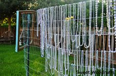 Getting a bunch of Mardi Gras beads and spray painting them to make them look like pearls.  I might do this!