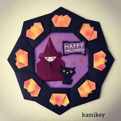 """かぼちゃが美味しい時期になりましたね〜土台のリースとまじょは15㎝、ねことかぼちゃは7.5㎝の折り紙で作っています ✳︎ 作り方動画は、YouTubeの""""kamikey origami""""でご覧ください(プロフィールにリンクがあります) ✳︎ Halloween Wreath designed by me Tutorial on YouTube """"kamikey origami """" #origami #折り紙 #kamikey"""