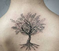 tree tattoo on woman's back: