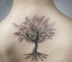 tree tattoo on woman's back: