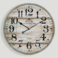 Norah Gray Wash Wood Clock from Cost Plus World Market. This clock is a perfect blend of vintage and industrial.