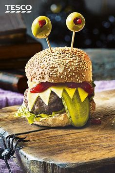 Monster Burgers Sink Your Teeth Into These Terrifying Burgers For A Freaky Halloween Feast Classic Beef Burgers Are Transformed Into Monsters With Cheddar Cheese Gnashers Gherkin Tongues And Goggling Olive Eyes Tesco Halloween Snacks, Plat Halloween, Comida De Halloween Ideas, Recetas Halloween, Hallowen Food, Halloween Dinner, Spooky Halloween, Halloween Sandwich, Halloween Food Ideas For Kids