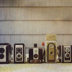 i have a serious love of vintage cameras. i love digitals quality, but vintage are beautiful and have style.