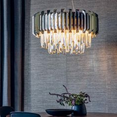 Stylish, retro-appeal chandelier featuring tiers of high quality, prism-shaped K5 glass crystals