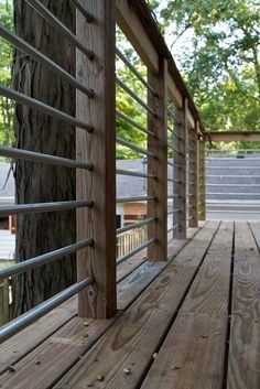 Metal railing for elevated deck. Made of conduit. Good for seeing through, and not overly ornate.