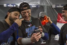Pillar & Tulo celebrate as the Blue Jays head to the postseason for the second year in a row