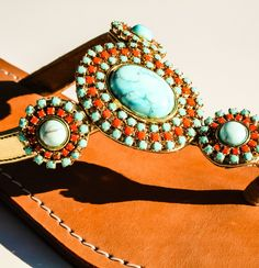 Gold with Turquoise and orange gems with a leather sole, suede lining and a inch heel. Coral Sandals, Thing 1, Gems, Turquoise, Leather, Rhinestones, Green Turquoise, Jewels, Gemstones