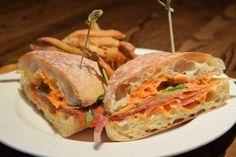 Bocadillo Sandwich, on ciabatta with shaved Serrano ham, chorizo,   Manchego, piquillo pepper aïoli and hand-cut rosemary fries   Green Valley Grill   Greensboro, NC