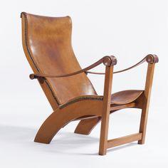"MOGENS VOLTELEN ""COPENHAGEN"" CHAIR mahogany, original leather and brass 37 1/4 in. (94.6 cm) high ca. 1936 produced by Niels Vodder, Copenhagen"