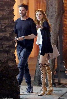 Dinner out: Patrick Schwarzenegger couldn't resist smiling while out to dinner with Bella ...