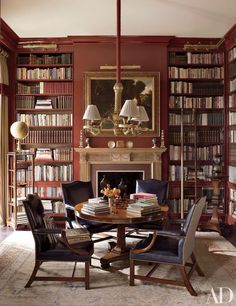 In the library, a varied collection of books, a 19th-century ladder, and an antique globe | archdigest.com