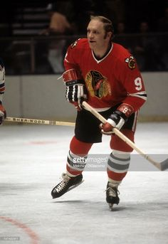 Bobby Hull of the Chicago Blackhawks skates on the ice during an NHL game against the New York Rangers circa 1972 at the Madison Square Garden in New York, New York. Chicago Blackhawks, Blackhawks Hockey, Bobby Hull, Nhl Games, Black Hawk, Hockey Cards, Sports Figures, New York Rangers, Hockey Players