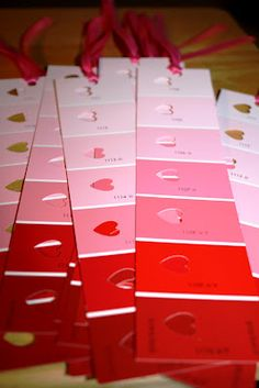 Valentine's Day bookmarks!  This would be a great idea for a teacher to give to her kids, for a child to give out to their classmates, or an activity for home!  How simple is this- go to the paint store and pick up a few of these pink/red sample cards!