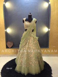 Stunning pista green color lehenga and gold sequence blouse with pists green color net dupatta. Lehenga and dupatta with floret lata design hand embroidery gold thread work. Party Wear Lehenga, Bridal Lehenga Choli, Ghagra Choli, Gold Lehenga, Sharara, Designer Party Wear Dresses, Indian Designer Outfits, Indian Gowns Dresses, Bridal Dresses
