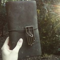 For me, the Olive is a creepy forest green with a shade of decay  ehat the heck is that ghostly white hand of mine lol #filofaxing #tn #travelers #notebook #travelersnotebook #midori #planner #planneraddict #planning #diary #filofax #journal #journaling #oliveedition2017 #olivetn #stationery