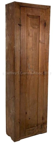 """Jeffrey Evans 6/17/17 lot 1337. Est: $400 - 600. Realized: $1,170.  Desc: VALLEY OF VA WALNUT CHIMNEY CUPBOARD, full-length raised panel door, on 3 iron butt hinges, 7 fixed shelves. Pine secondary wood. Early dry surface. Mid 19th c. 85 1/4"""" H, 25 3/4"""" W, 12 3/4"""" D.  Very good condition, wear to underside of front feet causing it to lean slightly, staining above base edge. Provenance: Va collection."""