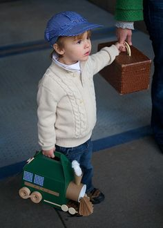 till getting ready to hop on the train with his train snack box.