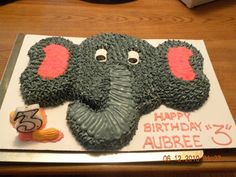 Elephant birthday cake for 3 year old. Made from two, cut 8 inch cakes. Buttercream icing. Circus peanuts for embellishment.