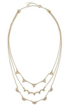 Stack up on style with this multi chain layered gold necklace. The Pave Chevron Necklace from Stella & Dot features a unique geometric shape for everyday wear.