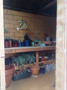 Transform an old, unused well house into a functional potting shed!