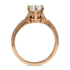 This enchanting Edwardian ring features an old European cut diamond. Wow.