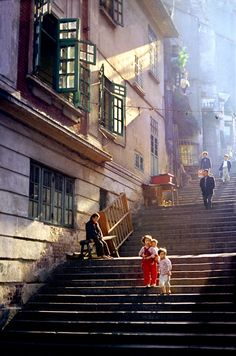 This almost doesn't look real, not at all like Hong Kong, but the children and the grandma show that it is. I liked how their clothes contrasted the colours. (Street of steps by Fan Ho) Cityscape Photography, Urban Photography, Color Photography, Nature Photography, Photography Lighting, Children Photography, Landscape Photography, Photography Ideas, Portrait Photography
