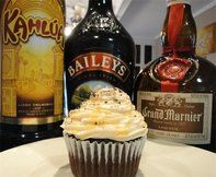 Alcohol- Infused Cupcakes -  Kahlua infused cupcake, topped with Bailey's Irish Cream frosting, and a Grand Marnier drizzle.