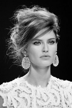 messy hair up do with big earrings