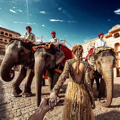 Natural beauties! Zakharova poses with the giant animals in front of the Amer Fort in Jaip...
