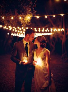 PERFECT, I am going to have candles, so we can do something like this... :)  Wedding couple, candles, nighttime wedding