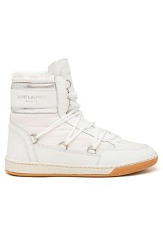 12 Winter Boots That Are Cute & Practical #refinery29  http://www.pipeline.refinery29.com/best-winter-boots#slide-4  The subtle moon boots of our dreams.Saint Laurent Shearling Snow Boots, $795, available at Browns....